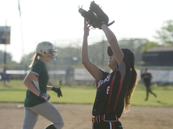 HALEY WARD | THE GOSHEN NEWS<br /> NorhWood senior Emily Schrock catches the pop-up ball to make an out during the sectional game against Tippecanoe Valley on Monday at Fairfield High School.