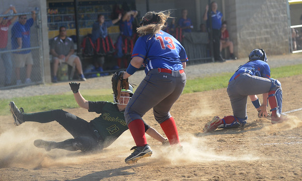 HALEY WARD | THE GOSHEN NEWS<br /> Wawasee junior Kayla White slides home to score against West Noble on Monday at Fairfield High School. Wawasee won 4-1 to advance in the tournament.