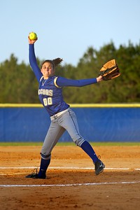 Menendez pitcher Destiney Passmore (00) prepares to throw the ball at the softball game against St Augustine High School on 3/26/2010.