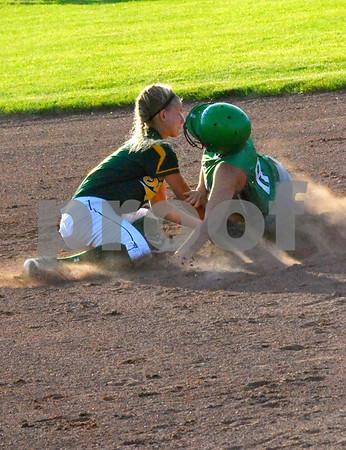 - Messenger photo by Britt Kudla<br /> St. Edmond's Katy Bocken steals second base against Saydel on Tuesday night at Roger's Park