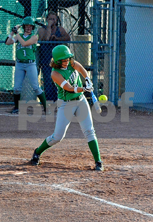 - Messenger photo by Britt Kudla<br /> St. Edmond's Anna Yung hits a line drive towards third base on Tuesday night against  Saydel
