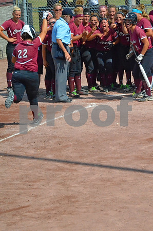 -Messenger photo by Britt Kudla<br /> Carley Robins of Clarke celebrates with her teammates after she hit a home run in fifth inning against New Hampton on Thursday at Roger Park
