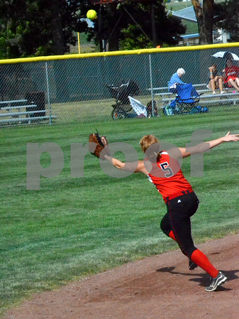 -Messenger photo by Britt Kudla<br /> Nicole Mulford of New Hampton attempts a diving catch for a fly ball during Thursday's 3A semifinals against Clarke at Rorge Park