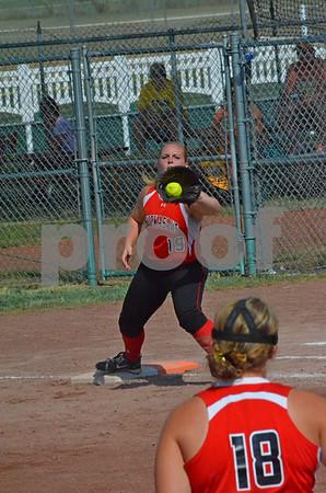 -Messenger photo by Britt Kudla<br /> Megan Fitzgerald of New Hampton receives the ball from third baseman Jennifer Ankrom during Thursday's 3A semifinal against Clarke