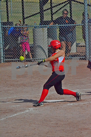 -Messenger photo by Britt Kudla<br /> Allie Geerts of New Hampton connects for a hit against Clarke on Thursday at Roger Park