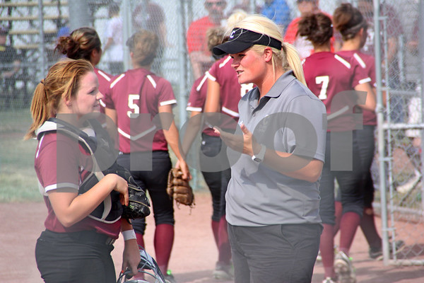 -Messenger photo by Britt Kudla<br /> Kassidy Spurgin of Clarke, Left, disscus thursday game against New Hampton with head coach