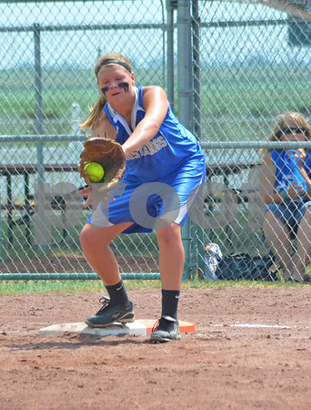 -Messenger photo by Britt Kudla<br /> Hailey Falline of Newell-Fonda catches the throw from third baseman Brianna Wells against New London in Thursday's 1A Semifinals at Roger Park
