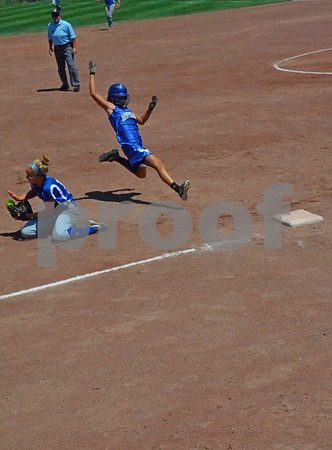 -Messenger photo by Britt Kudla<br /> Brianna Wells slides into third against St. Mary on Monday at Roger Park