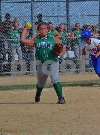 -Messenger photo Britt Kudla<br /> Katie Donnelly of St. Edmond throw out the runner at first on Wednesday during the Consolation final agaist Jesup