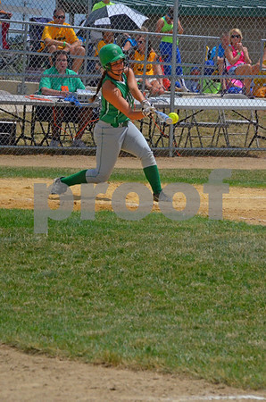-Messenger photo by Britt Kudla<br /> Josie Heesch of St. Edmond connects for a double, bringing two runs home on Wednesday 2A match against Lawton-Bronson at Roger Park's Yanknee Diamond