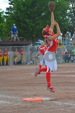 -messsenger photo by Britt Kudla<br /> Dani Heritage of dallas center-grimes makes a leaping catch on friday against carlisle at Roger park