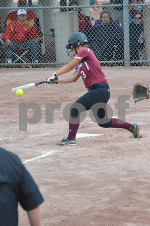 -Messenger photo by Britt Kudla<br /> Ashley Gibbs of Clarke connects for a hit against the Lady Jays on Friday