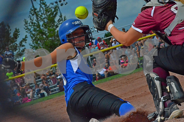 -Messenger photo by Britt Kudla<br /> Cailey Schlenker of Bondurant-Farrar scores the first run against Clarke on Friday