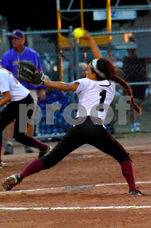 -messenger photo by Britt Kudla<br /> Claudia Farrell of Dowling catholic pitches her team to a victory over Johnson on Friday night at Roger park