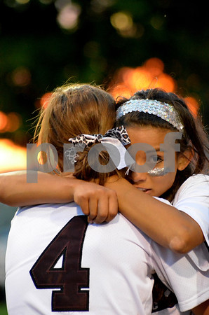-Messenger photo by britt kudla<br /> Alicia Crivaro of Dowling Catholic give teammate Claudia Farrell a hug after Dowling beats Johnson in the 5A final on friday at Roger Park