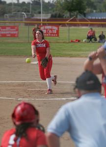 Lindsay Cardinal pitcher Kassidy Kendig throws againts Strathmore on April 4, 2013.