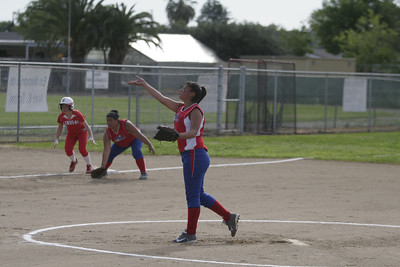Strathmore Spartan pitcher Anita Martinez (3) pitching against Lindsay on April 4, 2013.