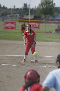 A Kassidy Kendig (Lindsay Cardinal) pitch against the Strathmore Spartans on April 4, 2013.