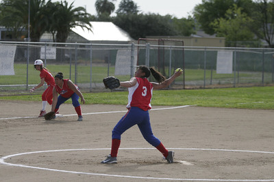 Anita Martinez  (3)  of Strathmore  pitching against the Lindsay Cardinals on April 4, 2013.