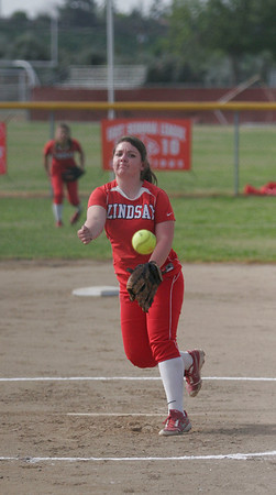 Lindsay Cardinal Kassidy Kendig (15)  throwing a strike against Strathmore on April 4, 2013.