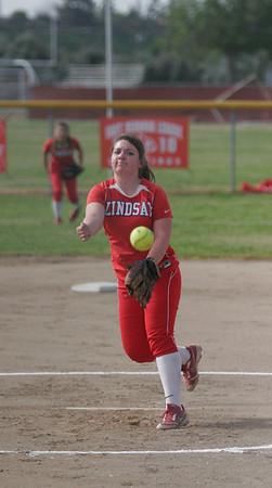 Lindsay Cardinal Kassidy Kendig (15)  throwing a strike against Strathmore on April 4, 2013.