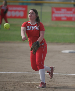 Lindsay Cardinal pitcher Kassidy Kendig (15) throws a pitch against Strathmore on April 4, 2013.