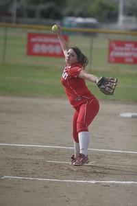 Lindsay Cardinal pitcher Kassidy Kendig (15) winds it up against Strathmore -April 4, 2013.