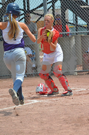 -Messenger photo by Britt Kudla<br /> Kristen Zacharias of AGWSR attempts to steal home against Treynor during Thursday's 2A Semifinal at Roger Park