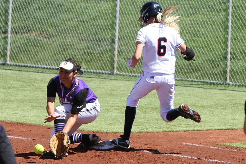 Kayla Oranger beats the throw to first.