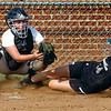 #14 for Eastside slides under the Northwood catcher's tag at home. Photo by Ned Jilton II