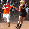 #21 for Honaker reaches first safely as the ball sails over Eastside's #10 at firstbase. Photo by Ned Jilton II