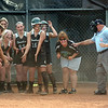With her Eastside teammates waiting at home plate, #6 finishes trotting around the bases after hitting a three run homer to break the tie and give Eastside a 6-3 lead over Honaker. Photo byNed Jilton II