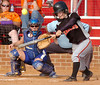 VHS's #7 Aubree Hutt connects as Coeburn catcher Catherine Nixon watches. Photo by Ned Jilton II
