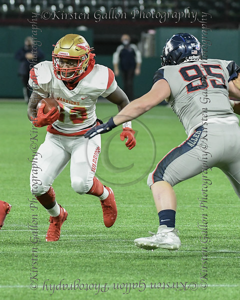 SGP RB #23 Javarius Crawford hits the gap for a gain as an Allen DE #95 Elijah Fisher closes in.