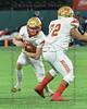 SGP quarterback #14 Robert Sims finds room to run around his blocker #72 Abraham Ellis.