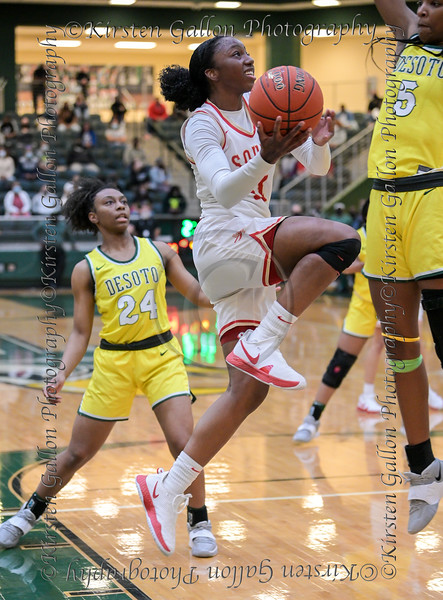 #11 Jahcelyn Hartfield penetrates a stingy DeSoto defense on her way int for a lay-up.