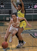 #3 Kiara Jackson drives around #3 DeSoto guard Kayla Glover to bring the ball up court against a full court press by DeSoto.