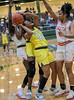 #23 DeSoto guard Kendall Brown grabs her own rebound and tries to shoot again in a crowd of SGP players. <br /> South Grand Prairie High girls basketball takes on DeSoto High girls basketball team in the Texas State 6A semi-finals.