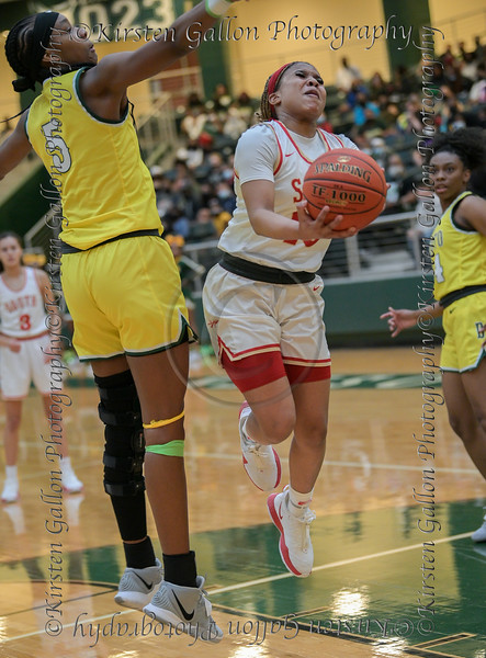 #10 SGP guard Victoria Dixon drives the lane like a boss for a lay-up against #5 DeSoto center Sa'Myah Smith.<br /> South Grand Prairie High girls basketball takes on DeSoto High girls basketball team in the Texas State 6A semi-finals.