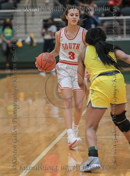 #3 SGP guard Kiara Jackson eyes her opponent as she sets up a play. <br /> South Grand Prairie High girls basketball takes on DeSoto High girls basketball team in the Texas State 6A semi-finals.