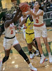 #5 SGP center Nxerra Mulaw and #3 SGP guard Kiara Jackson both attempt to grab the rebound.  <br /> South Grand Prairie High girls basketball takes on DeSoto High girls basketball team in the Texas State 6A semi-finals.
