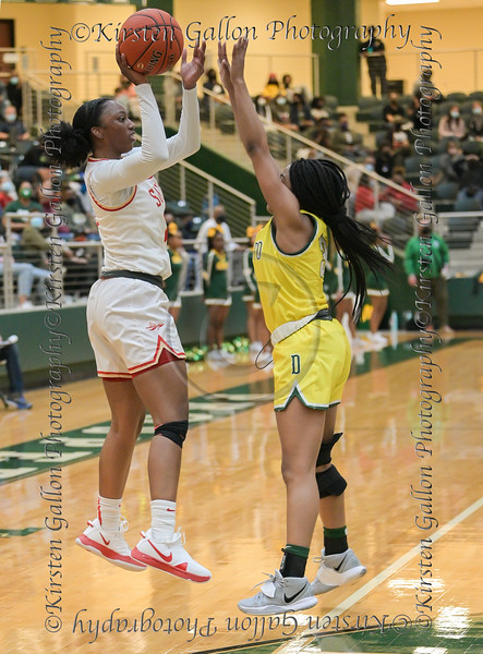 #11 Jahcelyn Hartfield makes a pass over the arms of #3 DeSoto guard Kayla Glover.<br /> South Grand Prairie High girls basketball takes on DeSoto High girls basketball team in the Texas State 6A semi-finals.
