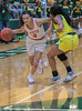#3 SGP guard Kiara Jackson gives an elbow to the chin of #3DeSoto guard Kayla Glover as she drives around her. South Grand Prairie High girls basketball takes on DeSoto High girls basketball team in the Texas State 6A semi-finals.