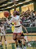 Jahcelyn Hartfield goes for the underneath-the-basket,  reverse lay-up against the defense of #5 DeSoto' Sa'Myah Smith. South Grand Prairie High girls basketball takes on DeSoto High girls basketball team in the Texas State 6A semi-finals.