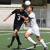 Matt Hamilton/The Daily Citizen<br /> DH3 and SE14 battle for a header.