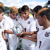 Matt Hamilton/The Daily Citizen<br /> SE players take a break from celebrating to look at the trophy a little more closely.