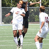 Matt Hamilton/The Daily Citizen<br /> SE11 and DH10 battle for a header.