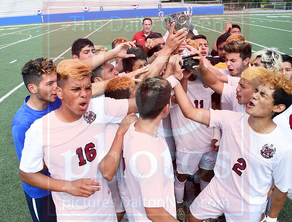 Matt Hamilton/The Daily Citizen<br /> The southeast players celebrate with the trophy.