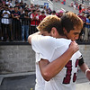 Matt Hamilton/The Daily Citizen<br /> SE10 and SE13 hug at the conclusion of the game.