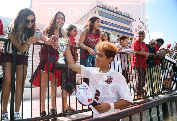 Matt Hamilton/The Daily Citizen<br /> SE2 lets fans touch the trophy after the win.